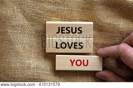Jesus Loves You Symbol. Concept Words 'jesus Loves You' On Wooden Blocks On A Beautiful Canvas Backg