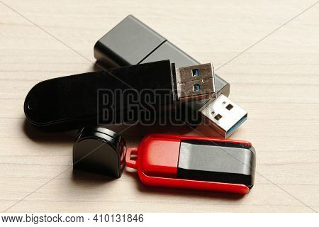Usb Flash Memory Sticks At Wooden Background. Top View. Portable Storage Device.
