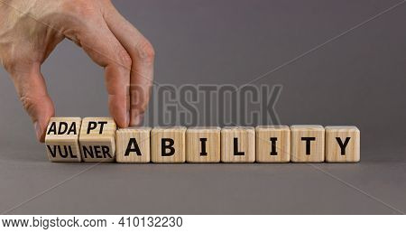 Vulnerability Or Adaptability Symbol. Businessman Turns Wooden Cubes And Changes Words 'vulnerabilit