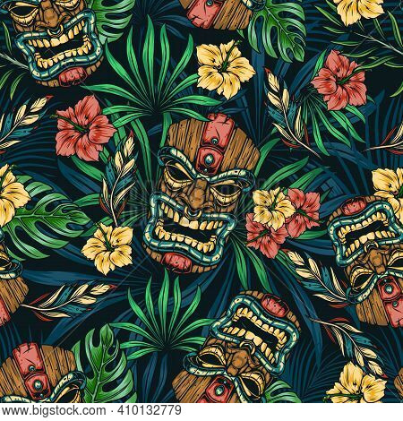 Hawaiian Tropical Colorful Seamless Pattern With Tribal Tiki Mask Hibiscus Flowers Monstera And Palm