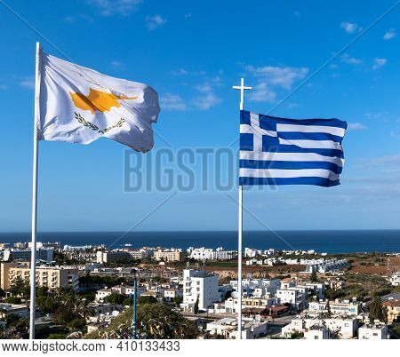 Flags Of Cyprus And Greece On Background Of Resort Town And Sea In Republic Of Cyprus