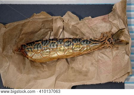 Smoked Mackerel In A Grid On Paper Top View. Headless Mackerel Carcass, Smoked Fish.