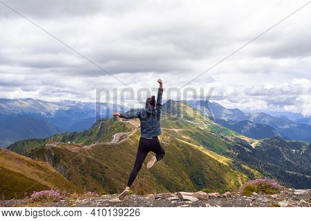 Superhero Jump In The Mountains Against The Sky. Ambition And Purpose, Concept.