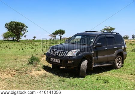 Rift Valley Province, Kenya - January 28, 2021: Offroad Car Toyota Land Cruiser Prado 120 In The Afr