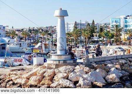 Agia Napa, Cyprus - August 16 2020: People On The Promenade At Agia Napa's Port