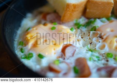 Pan Fried Egg Topping With Thai Sausage. Close Up