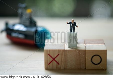 Miniature People Politician Stand On Podium With Symbol X And O During A Public Speaking And With Bl