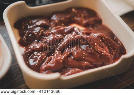 Fresh Pork Liver On White Plate For Cooked Or Sukiyaki Or Shabu Shabu