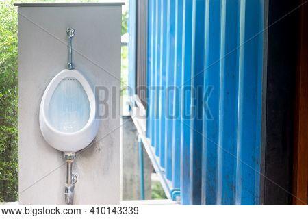 Close Up Of Urinal Men Public Toilet At Outdoor  Bathroom