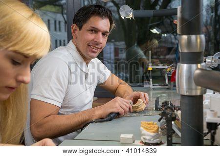 Dental Technician Polishing Dental Prosthesis