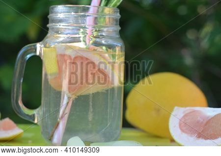 Healthy Detox Smoothie With Fresh Fruits And Green Rosemary Grapefruit Water. Lifestyle Detox Concep