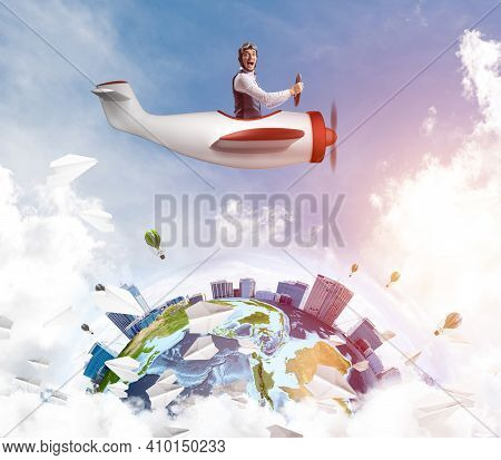 Man In Aviator Hat With Goggles Driving Propeller Plane. Earth Globe With High Modern Buildings. Fun