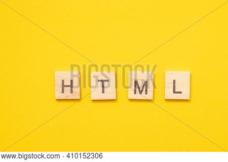 Word Html Made From Wooden Letters On Yellow Background. Programming Language For Web Site Developme