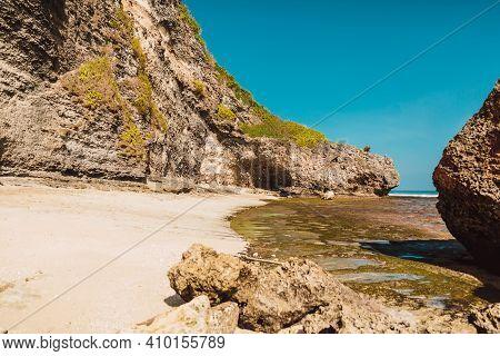Ocean Beach  At Low Tide Near Rocks In Bali, Uluwatu