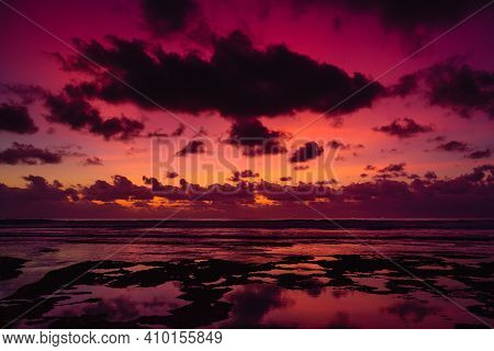 Colorful Sunset Or Sunrise With Clouds At Beach In Bali.