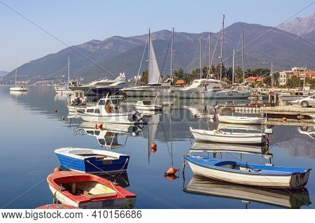 Beautiful Misty Mediterranean Landscape With Fishing Boats On Water. Montenegro, Adriatic Sea, View