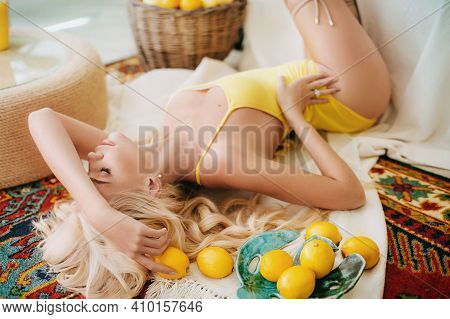 Portrait Of A Beautiful Young Woman In A Summer Gazebos With Fruits