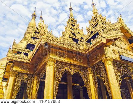 Close Up Focus To The Top Of Pagoda Shwedagon Pagoda At Dusk On Cloud Blue Sky Background In Sunny D