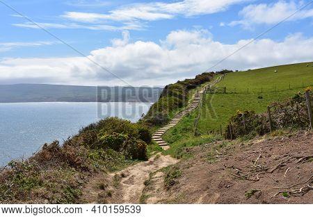 Stunning Dirt Path Along The Sea Cliffs Of England.