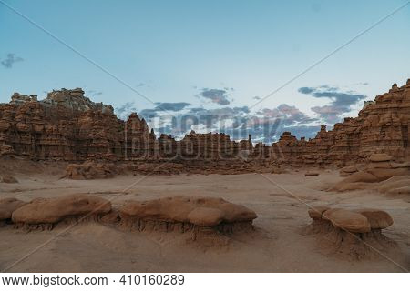 Goblin Valley State Park At Sunset With Pink And Blue Sky In The Background In Utah.