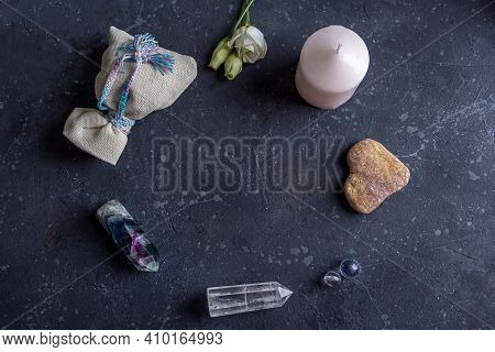 Magic Flat Lay Composition With Pink Candle, Crystals, Pagan Bag And Flowers. Esoteric And Pagan Rit