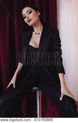 Photo Of Beautiful Young Brunette Woman In A Casual Black Clothes