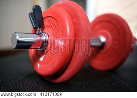 Paris, France - February 26, 2021 : Closeup Of A Dumbbell And Some Free Weights