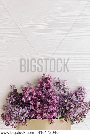 Happy Mothers Day And Womens Day. Creative Floral Greeting Card. Spring Lilac Flowers Blooming From