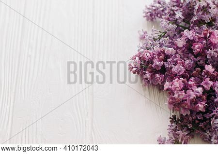 Tender Lilac Flowers Close Up On White Wooden Background In Soft Light,  Space For Text. Happy Mothe