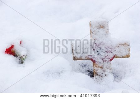 Remembrance Cross With Red Poppy In The Snow