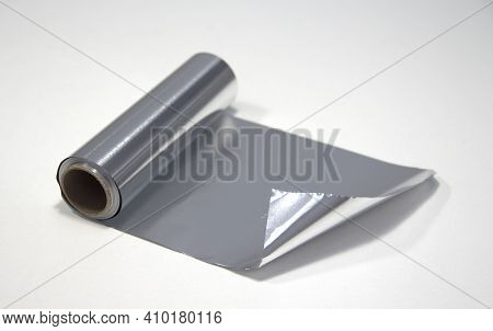 A Roll Of Aluminum Foil On A White Background. Foil For The Hairdresser