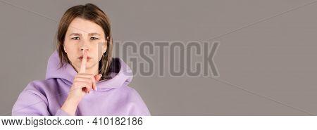 Woman Ready To Tell Secret Of Beauty. Portrait Of Charming Flirty Female Making Shush Or Shh Gesture