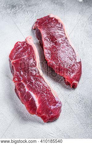 Fresh Raw Sirloin Beef Meat Steak. White Background. Top View