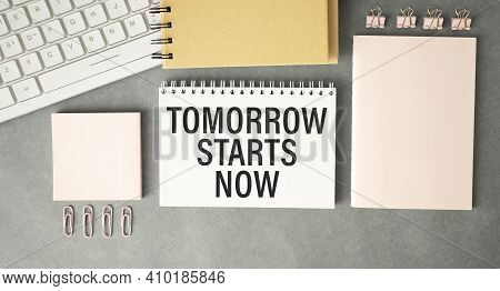 Tomorrow Starts Now Written In A Notebook With Coffee And Pen. Motivation Concept