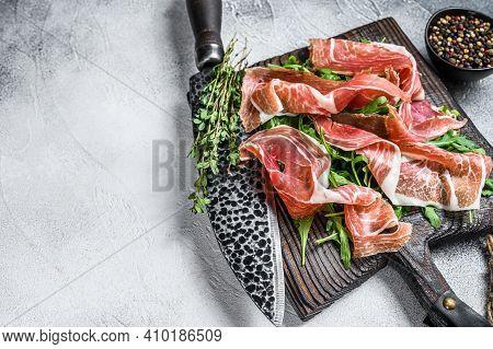 Sliced Spanish Jamon Serrano Ham Or Prosciutto Crudo Parma Ham. White Background. Top View. Copy Spa