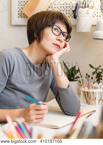 Woman With Short Hair Cut Is Drawing In Notebook. Calming Hobby, Antistress Leisure. Artist At Work.