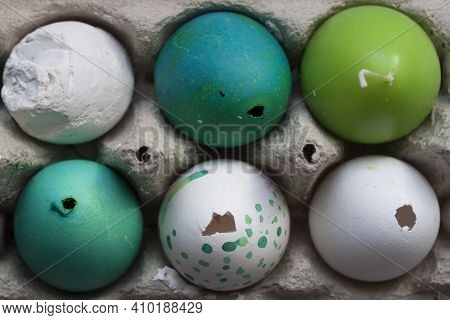 Green And White Easter Eggs In Egg Carton. Candle Egg, Gypsum Egg, Poultry Egg, Ground. Close Up. Ru
