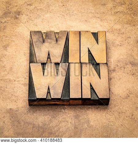 win-win - negotiation or conflict resolution strategy  -  word abstract in vintage letterpress wood type against handmade paper