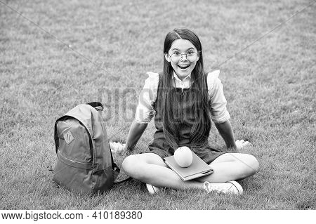 Rest A While And Run A Mile. Happy Kid Relax On Green Grass. Fruit Snack. School Snack. Nutrition Ed