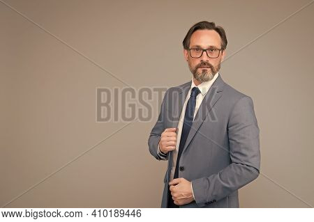 Portrait Of Mature Man Wearing Glasses. Adult Financial Director In Suit. Best Business Trainer. Ski
