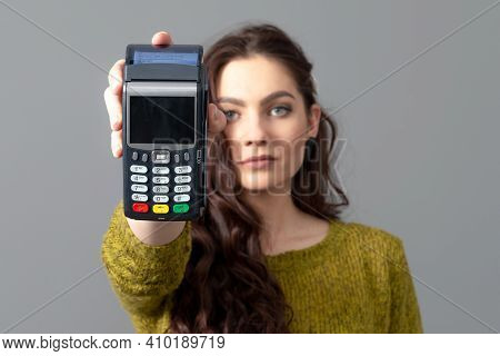 Woman Holding Wireless Modern Bank Payment Terminal To Process And Acquire Credit Card Payments