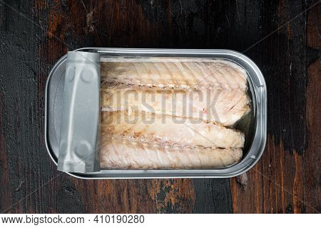 Canned Mackerel Fillets In Tin Set, In Tin Can, On Old Dark  Wooden Table Background, Top View Flat