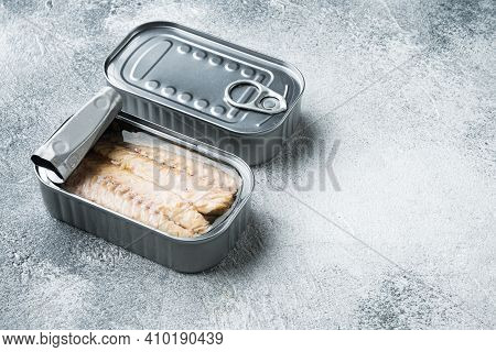 Canned Mackerel Fillets In Tin Set, In Tin Can, On Gray Background, With Copyspace  And Space For Te