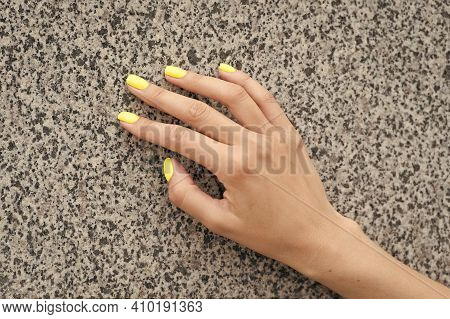 Professional Nail Care. Female Hand With Yellow Nail Color. Applying Nail Lacquer. Nail Salon Manicu