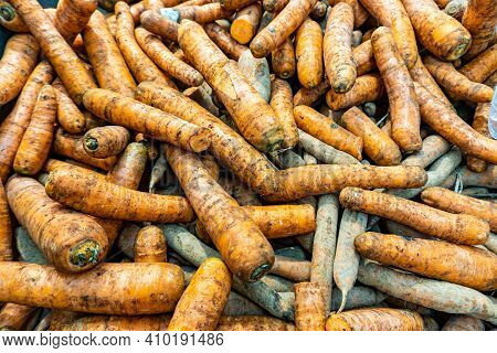 Dirty Carrots In Store. Carrots On The Shelf Of Supermarket. Fresh Carrots On The Counter Of A Groce