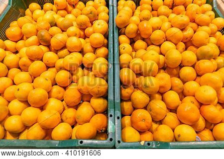 Assorted Citrus On The Market Counter. Fresh Oranges, Tangerines And Clementines As Food Background