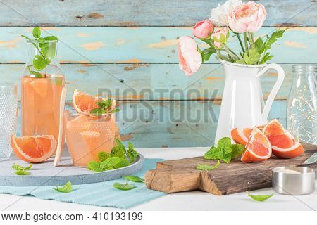 Grapefruit Juice With Mint In Glasses On The Table. Refreshing Summer Cocktail.