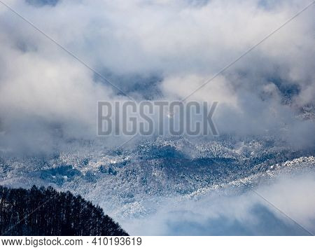 Clouds And Mist Rise Above The Forests In The Foothills Of The Japanese Alps In Nagano Prefecture, J