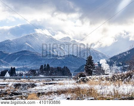 The Mountains Of The Japanese Alps As Seen From The Yomase River In Yamanouchi, Nagano Prefecture, J