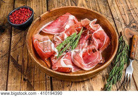 Spanish Sliced Jamon Serrano Pork Ham. Wooden Background. Top View